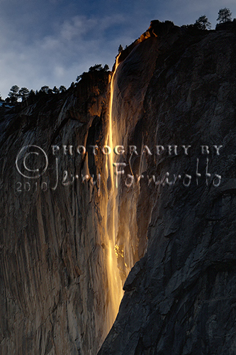"Horsetail Fall is a waterfall that flows over the edge of El Capitan in Yosemite Valley. For two weeks in February, the setting sun striking the waterfall creates a deep orange glow that resembles Yosemite's historic ""Firefall."""