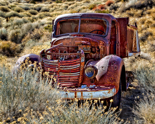 An old rusty truck by an abandon mine in Death Valley National Park.