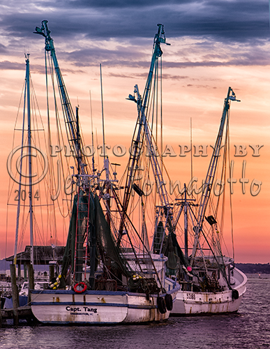 While traveling to Charleston, South Carolina I visited Kiawah Island. My wife and I were enjoying dinner at a nearby restaurant when I observed the beginning of a beautiful sunset. A short distance away was a fishing pier with two docked shrimp boats. The scene captured my eye.
