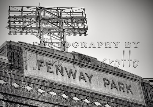 A black and white photo of the pediment of Fenway Park facing Yawkey Way, Boston Massachusetts.