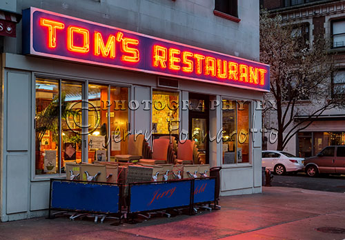 "Tom's Restaurant is located on the corners of Broadway and 112th Street, in the Morningside neighborhood of New York City, New York. The exterior of this diner was fictionalized in the TV show ""Seinfeld"". This restaurant inspired Suzanne Vega to write her song ""Tom's Diner"". Tom's is a favorite hangout for Columbia University students. Senator John McCain ate at the diner often when visiting his daughter when she attended Columbia."