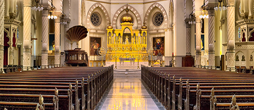 This is a panoramic view of the interior of the Immaculate Conception Jesuit Church.
