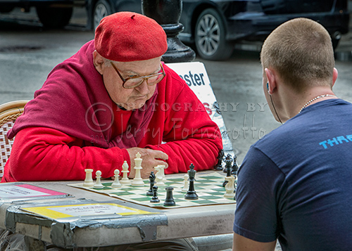 Jude Acers plays against all comers in a New Orleans downtown gazebo while wearing a red beret.