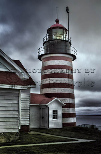 West Quoddy Head Lighthouse is the most eastern point of the contiguous U.S.. West Quoddy Lighthouse overlooks the strait between the U.S. and Canada and guide ships with a blinking white light. This red and white striped light was built in 1806.