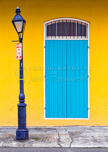 A colorful door and lamppost in the French Quarter of New Orleans.