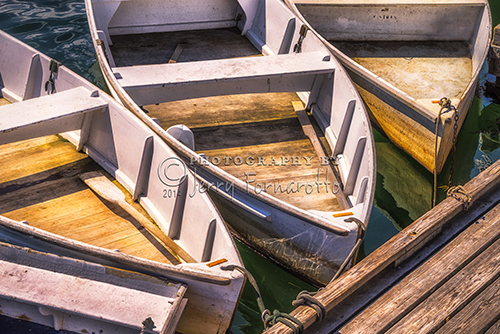 A group of dinghies moored at the dock at Perkins Cove, Ogunquit, Maine.