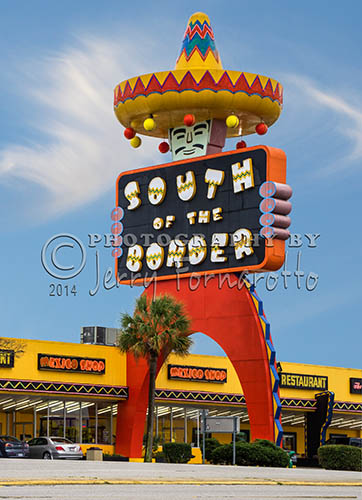 """South of the Border"" is a rest stop on Interstate 95 at the borders of South Carolina and North Carolina. This tourist stop was established in 1949. The giant 97 foot tall sign ""Pedro"" quickly became a landmark for weary travelers to stop."