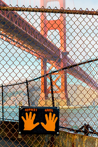 """""""Hoppers Hands"""" is located at Fort Point, under the Golden Gate Bridge, San Francisco. This sign offers inspiration to runners as a turn-around point. Thousands of joggers have been touching the plaque since Ken Hopper posted it in 2000 ."""
