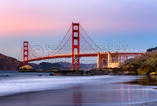 The Golden Gate Bridge spans the Golden Gate Strait between San Francisco and the Pacific Ocean. This suspension bridge is 1.7 miles long and 90 feet wide. The two towers reach 746 feet above the water. Baker Beach is public beach and is part of the Golden Gate National Parks Conservancy.
