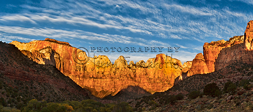"""The """"Towers of the Virgin"""" rise more than 3,500 feet from the Zion Canyon Valley. The peaks are named """"West Temple"""", """"Sundial"""" and """"Altar of Sacifice""""."""