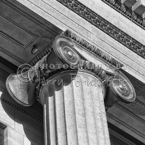 A Close up photo of an ornate ionic voluted capital found on the Philadelphia Museum of Art.