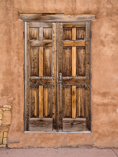 An old weathered wooden door found in Taos, New Mexico.