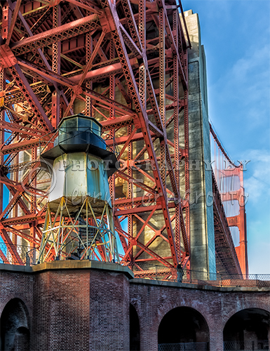 When the construction of the Golden Gate Bridge began in 1933, a fog signal and small lighthouse was put into service. When the bridge was completed the lighthouse was no longer necessary. The iron lighthouse still remains atop Fort Point dwarf by the bridge's south tower.