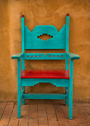 A photo of a vividly painted chair found in Oldtown section of Alburquerue, New Mexico.