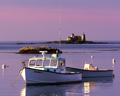 The sunrise view looking towards the Atlantic Ocean from Kittery Point, Maine. Whaleback Light and Wood Island Life Boat Station marks the entrance to the Piscataqua River.