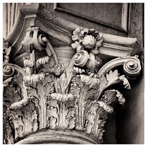 A black and white photo showing the details of a Corinthian Capital.