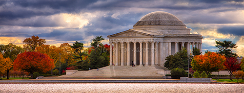 This is a panoramic color photo of the Jefferson Memorial in Washington D.C.. The memorial is located on the shore of the Potomac River Tidal Basin. The photo was taken on a stormy fall morning.