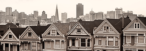 "Across from Alamo Square on Steiner Street, San Francisco is a row of Victorian houses dubbed ""Postcard Row"".  The San Francisco skyline is a wonderful background for these painted ladies. Painted Ladies are homes that are painted in three or more colors. These homes appear in the opening credits of the TV show ""Full House""."
