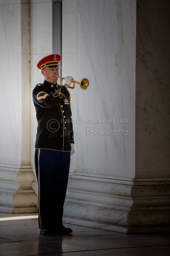 "A marine playing ""Taps"" at the Jefferson Memorial in honor of his birthday, April 13, 1743."