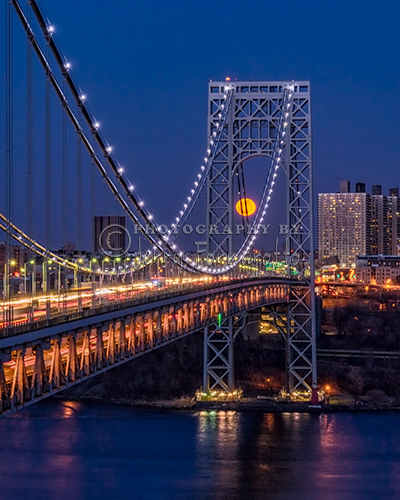 Supermoon rising behind the George Washinton Bridge, New York City, New York.