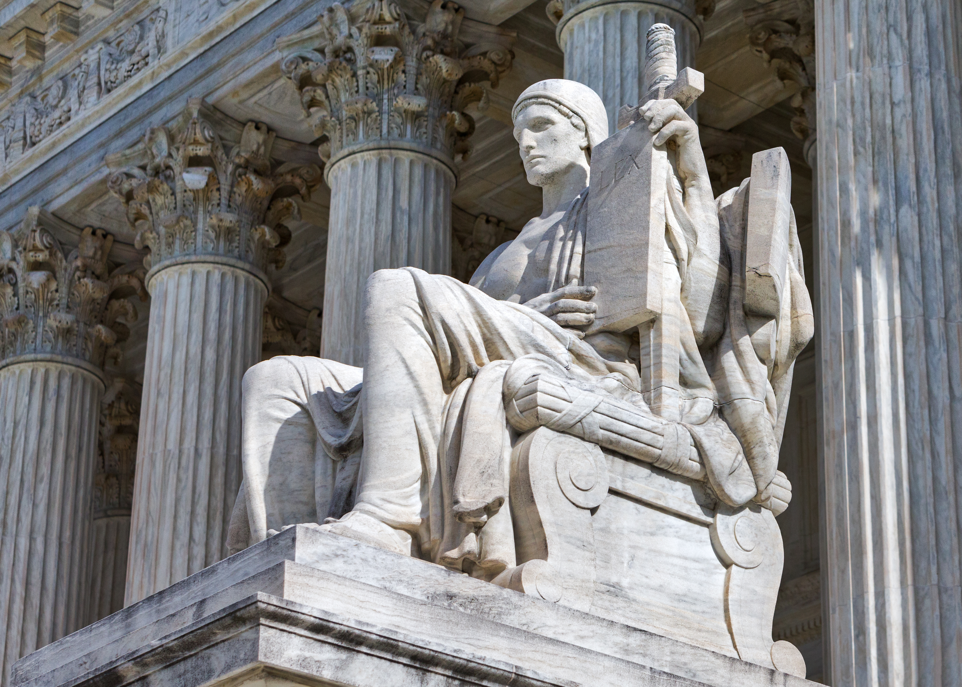 The Authority of Law, also called the Guardian or Executor of Law, is powerful, erect, and vigilant. He waits with concentrated attention, holding in his left hand the tablet of laws, backed by the sheathed sword, symbolic of enforcement through law.