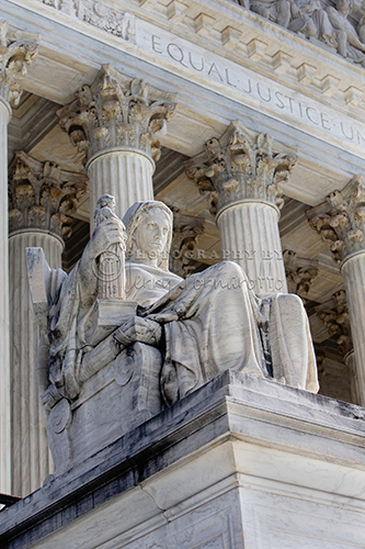 """At the entrance to the Supreme Court are two statues sculpted  by James Earle Fraser. This is the statue """"Contemplation of Justice""""."""