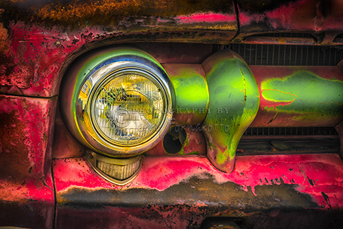 A HDR photo of a GMC 350 Truck grill and headlight.
