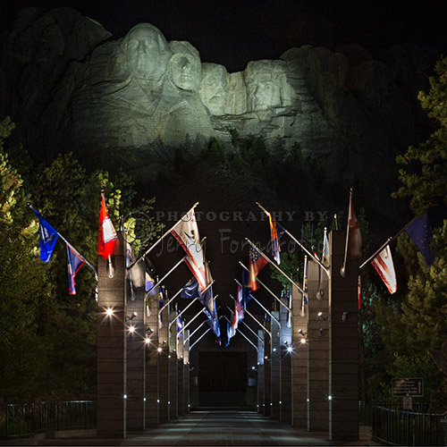 A night time view of Mount Rushmore from the promenade.
