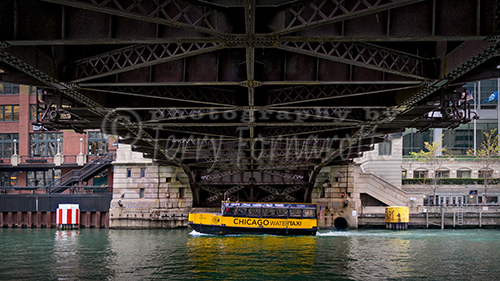 A Chicago Water Taxi passing under North Clark Street.