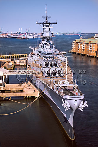 "The USS Wisconsin (BB-64) was launched in 1944. Nicknamed ""Wisky"" is an Iowa-class battleship. Wisconsin's main battery consisted of nine 16 inch/50cal Mark 7 guns, which could hurl 2,700 lb. armor-piercing shells 20 mi. During World War II she served in the Pacific Theater. ""64"" was an important part of the Korean War. It was then decommissioned. Subsequently she was updated in 1986. In 1991 Wisky participated in Operation Desert Storm. Wisconsin was again decommissioned in September, 1991. During her service she earned 6 battlestars as well as a Navy Unit Commendation. Now she rests in Norfolk, Virginia and is part of the National Maritime Center."