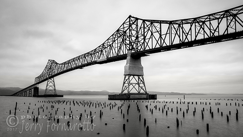 The Astoria-Megler Bridge crosses the Columbia River. This steel cantilever bridge is 4.1 miles long.