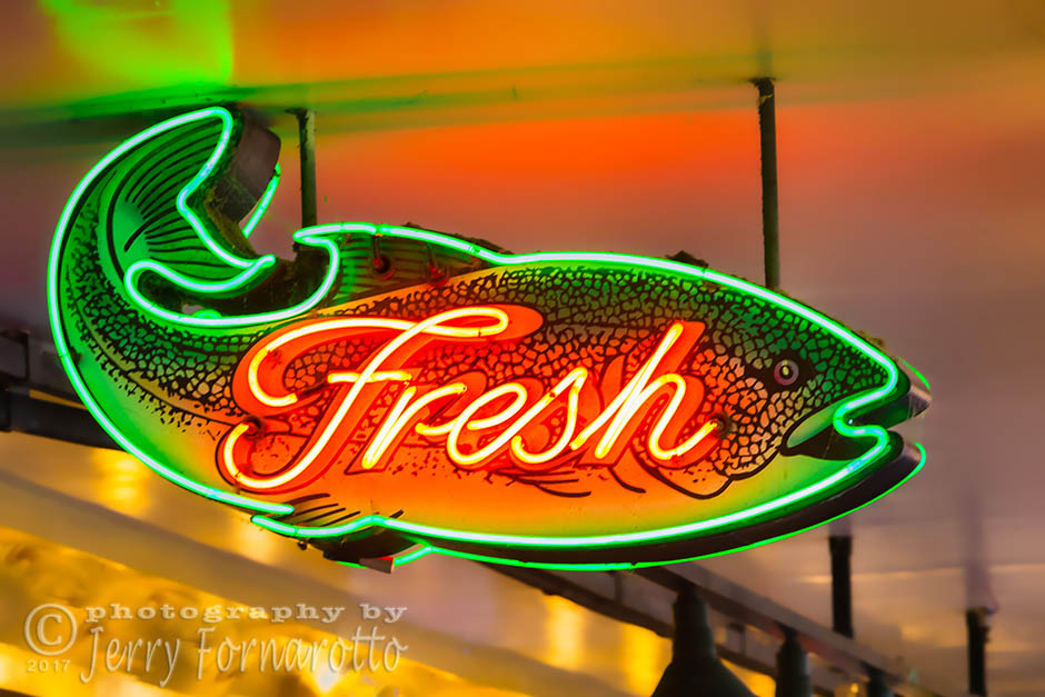Neon fish sign at Pike Place Market, Seattle, Washington. Canon 5D MKIV, Canon 70-200mm set to 200mm, 1/20sec, f10