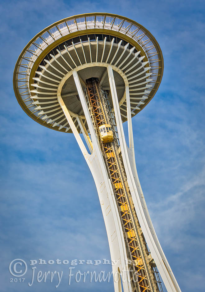 The Space Needle is located in Seattle Center. It is 605 feet tall. b