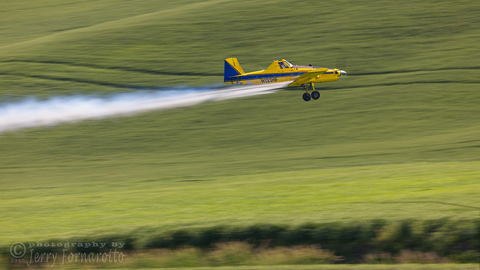 A Air Tractor AT-502 spraying a field in the Palouse, Washington.