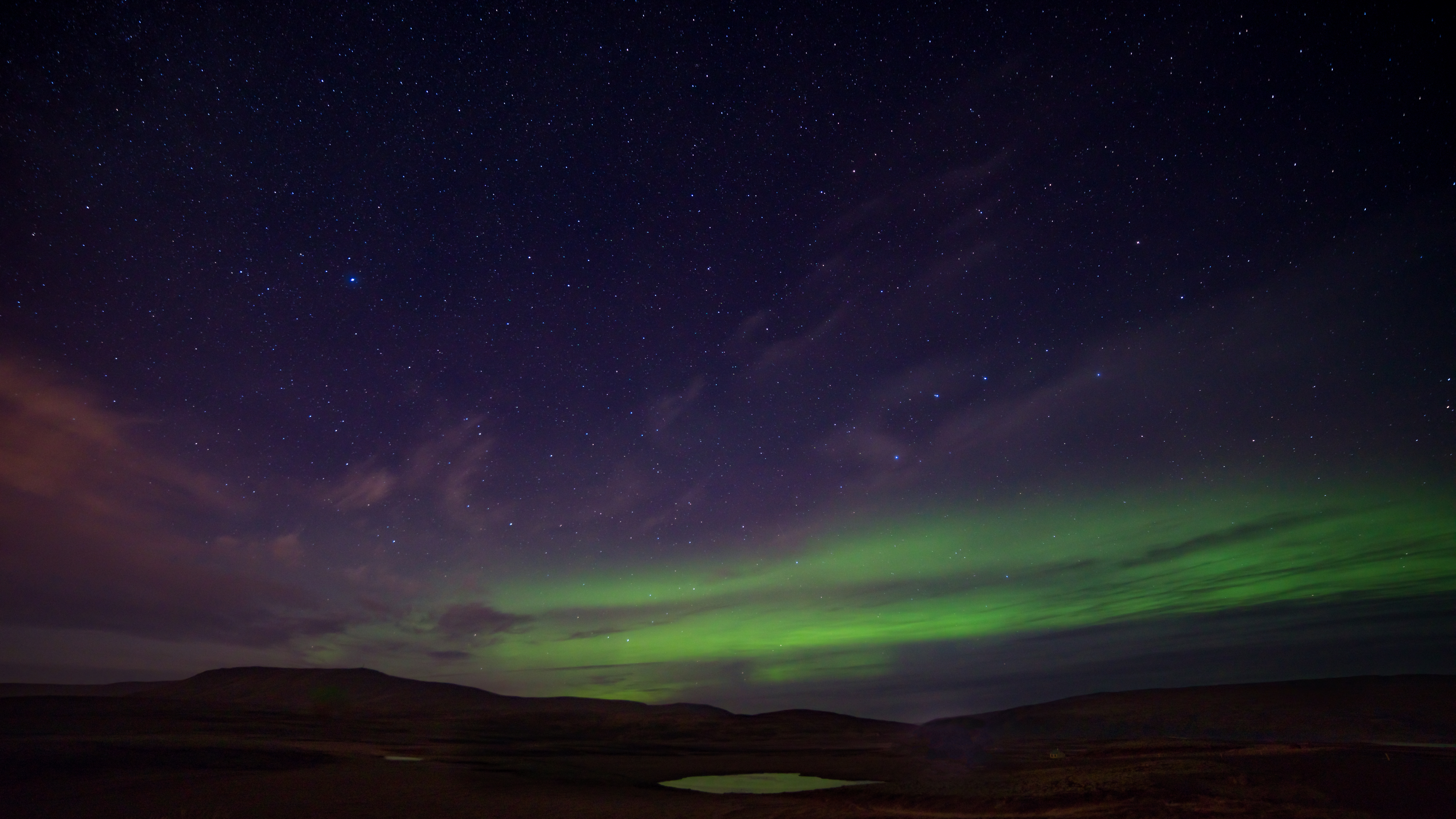 Auroras or northern lights are collisions between electrically charged particles from the sun that enter the earth's atmosphere.