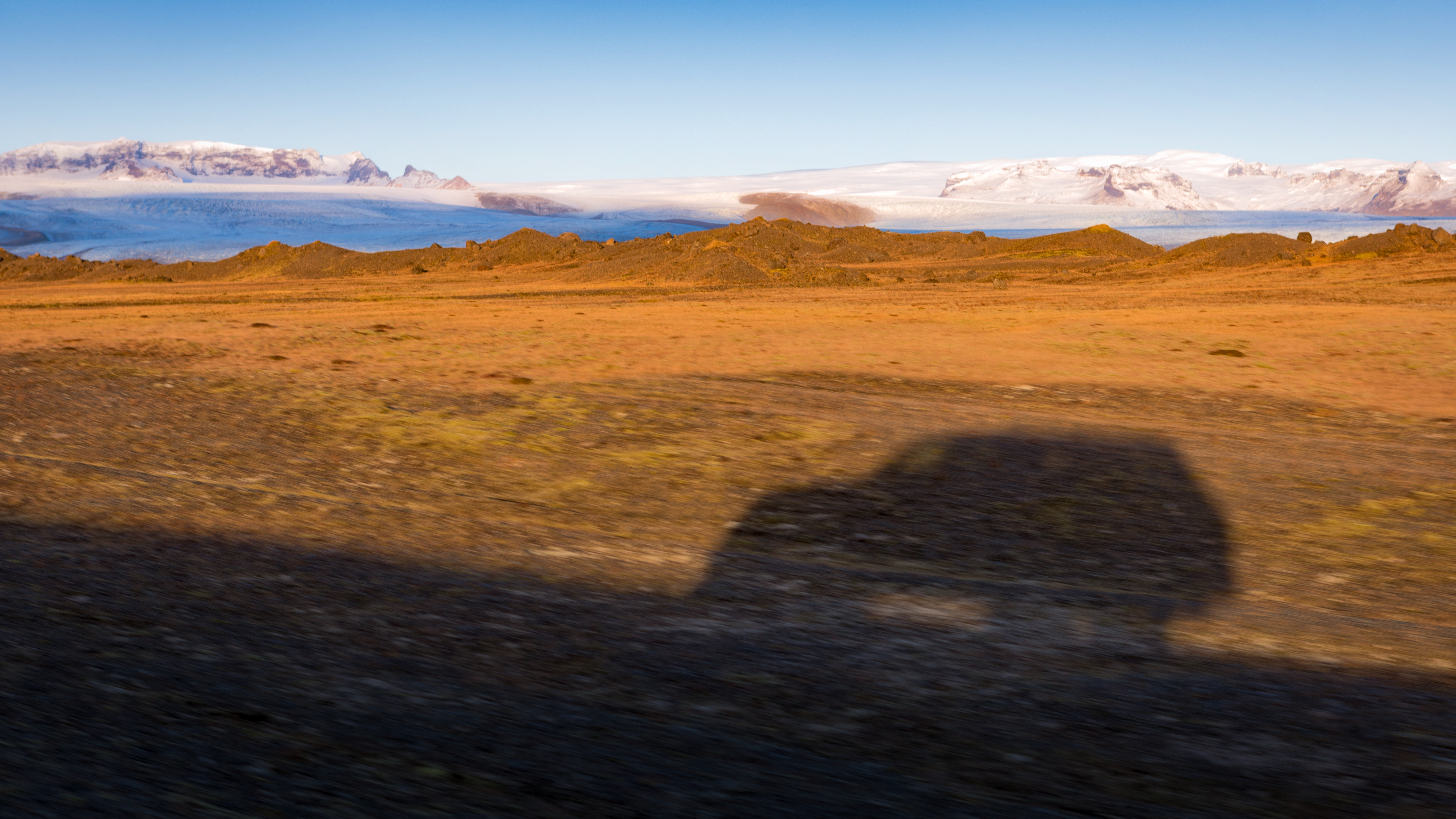The shadow of my cay while driving the Ring Road, Iceland.